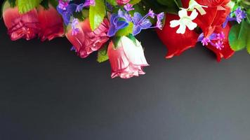 Memorial mockup with artificial flowers on a dark background photo