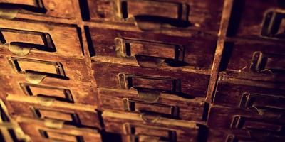Old wooden wardrobe with small drawers photo