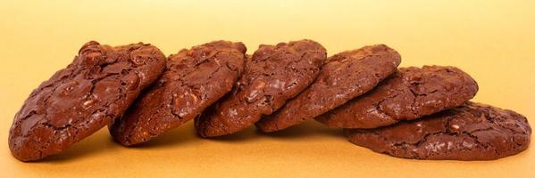 Glazed oatmeal cookies closeup on a yellow background photo
