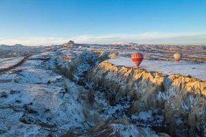 Hot air balloons fly over Cappadocia in winter, Goreme, Turkey