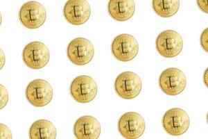Group of gold coins of bitcoin cryptocurrency isolated on white background photo