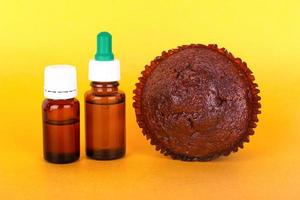 Chocolate cake with THC extract on a yellow background photo
