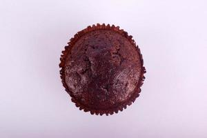 Chocolate muffin cake on a gray background photo