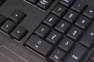 Black keyboard for messaging and writing text on a computer photo