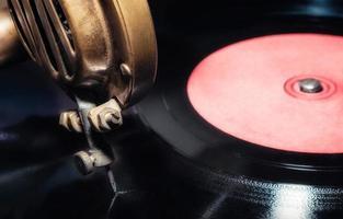 Vinyl record and vintage gramophone photo