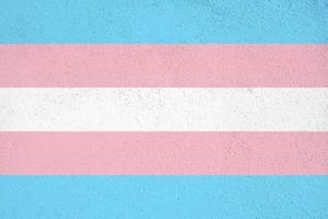 Transgender flag painted on concrete wall outdoors