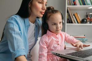 Parent helping child with e-learning