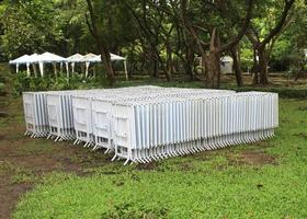 White row of chairs and tables in a garden