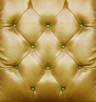 Golden sofa pattern surface for background photo