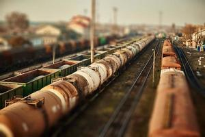Freight railway cars at the railway station. Top view of cargo trains. Wagons with goods on railroad. Heavy industry. Industrial conceptual scene with trains. Selective focus. photo