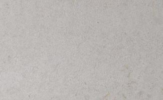Fondo de piedra beige, textura natural de travertino de cerca foto