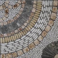 mosaico de piedras antiguas formando figuras foto