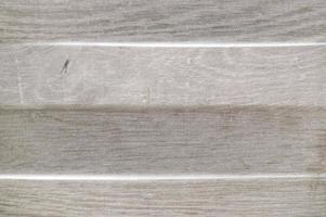 Wood-coloured porcelain texture with non-uniform relief photo