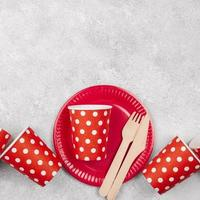 Disposable tableware red cups copy space photo