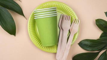 Eco friendly disposable tableware and cup top view copy space photo