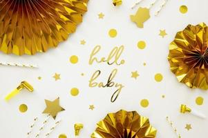 Baby shower gold decorations on white background with copy space photo