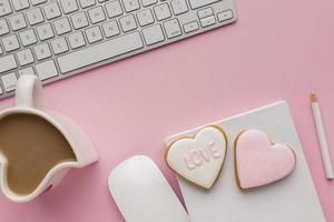 Valentine's Day coffee and cookies on desk top