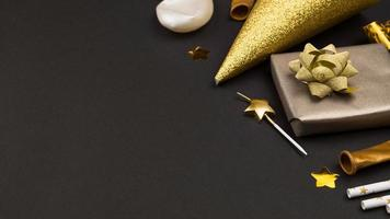 Black and gold birthday gifts with copy space