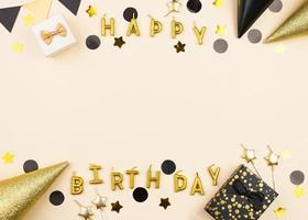 Happy Birthday decorations on yellow background photo