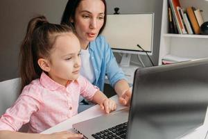 Parent and child e-learning from home photo