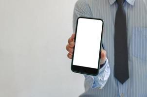 Professional holding blank phone mock-up photo
