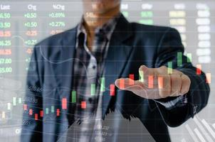 Businessman with stock chart concept photo
