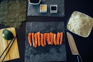 Sliced salmon on a cutting board photo