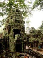 Siem Reap, Cambodia, 2021 - Tourists viewing Angkor Thom ruins photo
