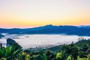 Foggy sunrise in Thailand photo