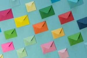 Line of envelopes of various colors. photo