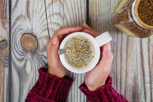 Woman hands with coffee cup photo