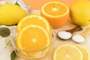 Sliced oranges and lemons photo