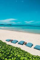 Beautiful tropical beach and sea with chair on blue sky photo
