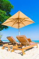 Sunbathing beds on the beach photo