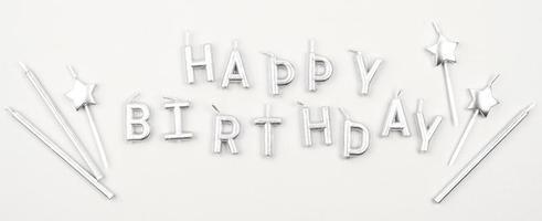 Happy birthday candles arrangement flat lay