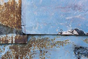 Rusty scratched blue wall photo