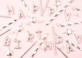 Happy Birthday decorations flat lay on pink background