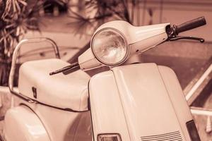 Vintage headlight lamp of a motorcycle photo