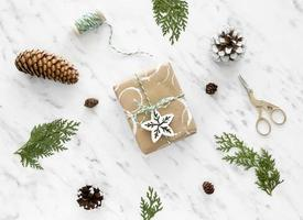 Christmas wrapping gifts with pinecones photo