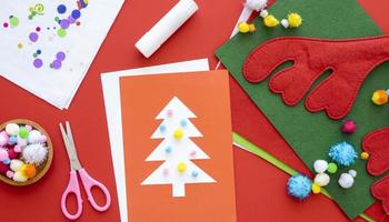 Christmas crafting supplies on red background photo