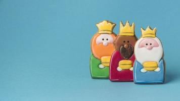 Three Kings decorated as cookies on blue background