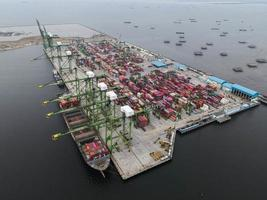 Jakarta, Indonesia 2021- Aerial view of container ship loading and unloading in deep sea port, import and export freight transportation