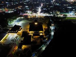 Bekasi, Indonesia 2021- Aerial drone view of Monument Gedung Juang, one of the historical buildings in Tambun at night photo
