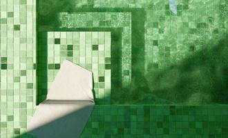 Top view of green tiled pool with a white towel, 3d rendering photo