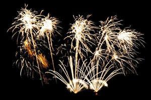 Beautiful fireworks display on black sky photo