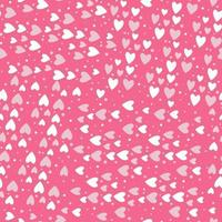 Seamless vector pattern of small randomly scattered hearts and dots