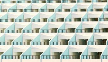 Facade of apartments with their terraces illuminated by the sun at sunset, 3d render photo