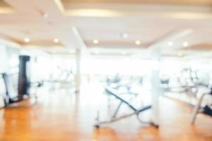 Abstract blur gym and fitness room interior for background photo