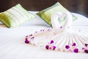 Swan towel on bed