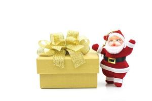 Santa decoration with gold present photo